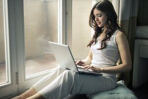 Girl Using Laptop 5k Wallpaper