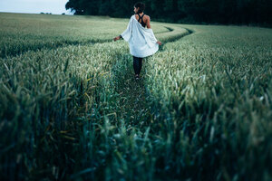 Girl Walking In Field Way
