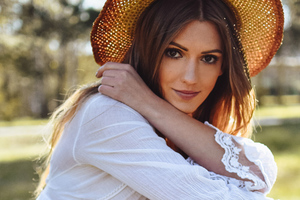 Girl Wearing Hat Outdoors Wallpaper