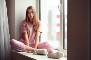 Girl Window Side Sitting 4k Wallpaper
