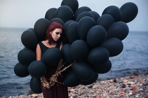 Girl With Black Ballons