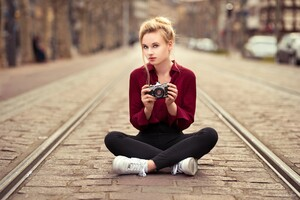 Girl With Camera Sitting On Tram Road Wallpaper
