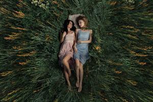 Girls Lying Back In Nature 5k Wallpaper