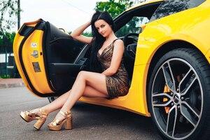 Gorgeous Girl Sitting In Sport Car