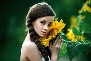 Green Eyes Girl Posing With Solidago Flowers Wallpaper