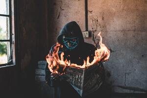 Hidden Mask Guy Burning Newspaper