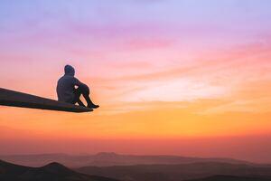 Hoddie Guy On Edge Watching Sunset