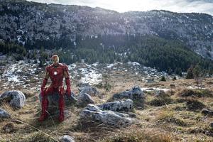 Iron Man Sitting On Stone Mountains