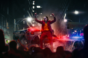 Joker Dancing On Police Car Wallpaper