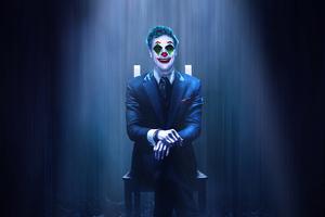 Joker Sitting On Chair Wallpaper