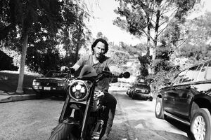 Keanu Reeves On Bike Wallpaper