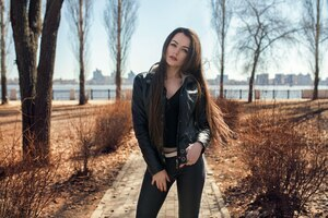 Leather Jacket Girl Outdoors Wallpaper