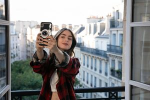 Lily Collins Taking Selfie Vogue Uk Wallpaper