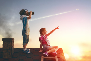 Little Childrens On Roof Watching Sky