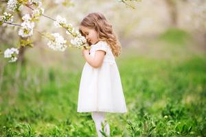 Little Cute Girl Smelling Flowers Wallpaper
