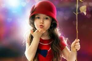 Little Girl Blowing a Kiss Wallpaper