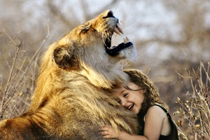 Little Girl Hugs Lion Roaring Cute 4k Wallpaper