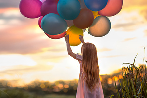 Little Girl With Colorful Balloons Wallpaper