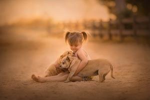 Little Girl With Cute Pups Wallpaper