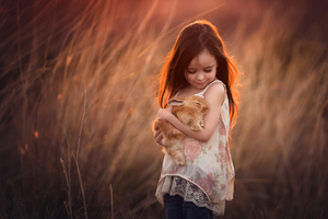 Little Girl With Rabbit In Hands 4k Wallpaper