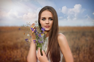 Long Hair Brunette With Flowers In Hand Field Wallpaper