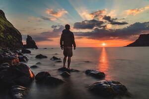 Looking Towards Sunset At Beach Wallpaper