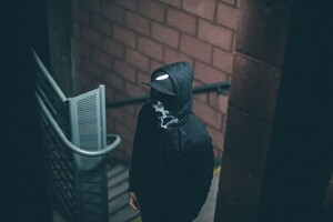 Man In Hood Smoking Wallpaper