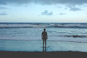 Man Standing At Ocean Shore