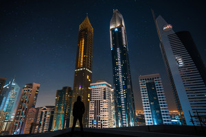 Man Standing Front Of Tall Buildings Wallpaper