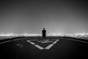 Man Standing Helipad Monochrome 5k Wallpaper