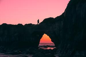Man Walking Over Rock Silhouette