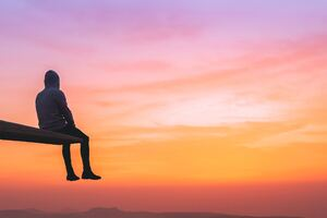 Man Watching Sunset On Top