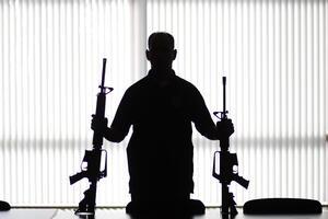 Man With Two Guns Wallpaper