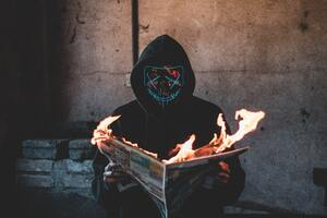 Mask Guy Reading A Burning News Paper