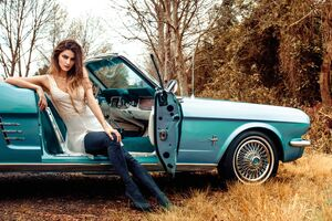 Model Sitting In Vintage Car