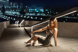 Model Sitting On Downstairs
