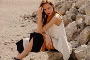 Model Sitting On Ground Wallpaper