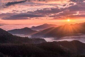 Mountains Fog Sunbeams Clouds 5k Wallpaper