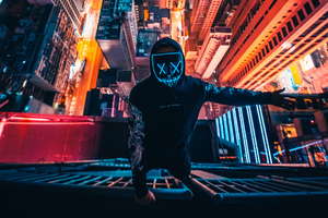Neon Mask Guy Climbing Building 4k Wallpaper