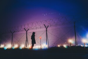 Night Lights Person Standing Behind Fence Silhouetee