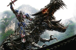 Optimus Prime On Dinobot Wallpaper