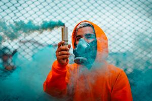 Orange Hoodie Guy With Smoke Wallpaper