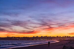 Person Standing Near Ocean Golden Hour