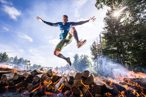 Player Jumping Out Of Burning Woods