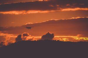 Prop Plane Passing Thorugh Clouds 4k Wallpaper
