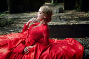 Red Dress Model Lying Closed Eyes 4k Wallpaper