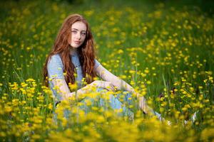 Redhead Girl Sitting Glance Grassland 5k
