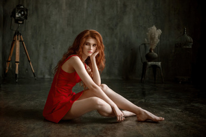 Redhead Red Dress Girl Sitting 4k Wallpaper
