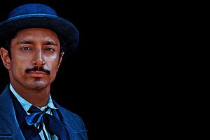 Riz Ahmed As Hermann Kermit Warm In The Sisters Brothers Movie