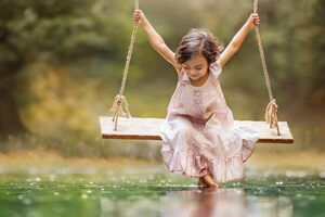 Small Girl Taking Swing Wallpaper
